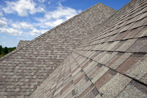 Homes roofed with asphalt shingles in Darien